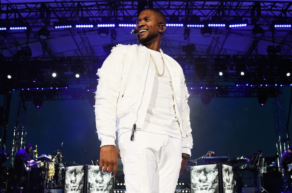 Usher performing at the iheartradio album release party in New York City. Photo courtesy of Billboard.com - link under resources.